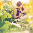 Young beautiful woman in sunflower field — Stock Photo