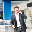 Handsome young businessman talking on his mobile — Stock Photo #28695555