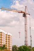 Crane and building at costruction site — Stock Photo