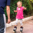Little girl on roller skates at park — Stock Photo