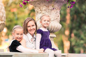 Happy family: mother with daughters — Stock Photo
