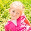 Cute smiling little girl on the meadow — Stock Photo