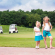 Stock Photo: Cute little gilrs on golf course