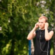 Sportive young man jogging outdoor — Stock Photo