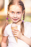 Happy cute child eating ice cream — Stok fotoğraf