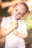 Happy cute child eating ice cream — Stock Photo