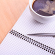 Open blank note book with coffee cup on table — Stock Photo