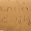 Word vacation on the yellow sandy beach — Stock Photo #31500709