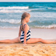 beautiful little girl excercising on the beach — Stock Photo