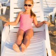 Adorable kid sunbathing on a beach — Stock Photo #32486269