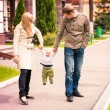 Happy family walking outdoor — Stock Photo #32698593