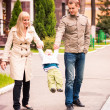 Happy family walking outdoor — Stock Photo