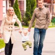 Happy family walking outdoor — Stock Photo #32698701