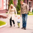 Stock Photo: Happy family walking outdoor