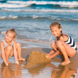 Adorable little girls playing at the seashore — Stock Photo