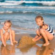 Stock Photo: Adorable little girls playing at the seashore