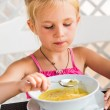 Cute child eating soup — Stock Photo #37132455