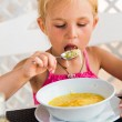Cute child eating soup — Stock Photo #37132859