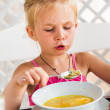 Cute child eating soup — Stock Photo #37133079