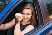 Beautiful businesswoman sitting in the car — Stock Photo