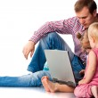 Father with children playing on laptop — Stock Photo #4379979