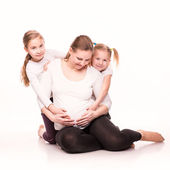 Happy pregnant woman with her kids — Stock Photo