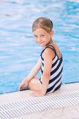 Cute little girl in swimming pool — Stock Photo
