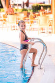 Cute little girl in swimming pool — Foto Stock