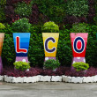Welcome sign word on flower pots — Stock Photo