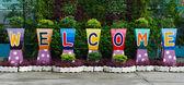 Welcome sign word on flower pots — Foto de Stock