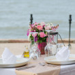 Stock Photo: Dinner setting on the beach