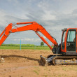 Excavator working in the farmland — Stock Photo