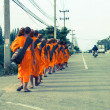 Thai monks are walking on street side,Thailand — Stock Photo