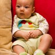 Cute baby sitting on sofa — Stock Photo