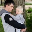 Young man and baby — Stock Photo