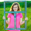 Girl and the window frame — Stock Photo