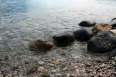 Stones in clear water — Stock Photo