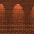Fragment of the shined brick wall with three spot light — Stock Photo