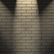 White brick wall with three light spots — 图库照片