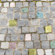 Elegant stone wall of a colored square parts — Stock Photo