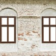 Old brick house wall with white windows — Stock Photo