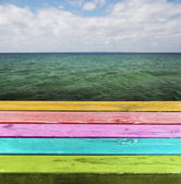 Blank Colorful wooden table. The table above sea green backgroun — Stock Photo