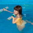Royalty-Free Stock Photo: Attractive girl trains in aqua aerobics