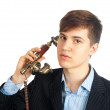 Young man talking on retro phone - Stock Photo