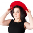 Young beautiful woman with red hat — Stockfoto