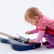 Little girl playing with guitar — Stockfoto #12938030