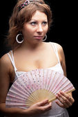 Attractive woman with a fan — Stock Photo