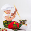 Baby girl in the cook hat — Stock Photo