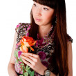 Stock Photo: Pretty woman with flower