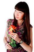 Pretty woman with flower — Stock Photo